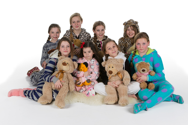 Makeover and photoshoot party of girls in onesies and teddy bears