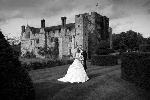 Black and white photograph of bride and groom at Hever Castle in Kent