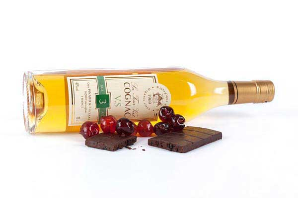 Product photography brandy, chocolate and cherries
