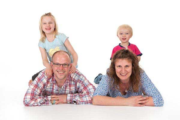 Fun family photograph of parents and their children during photoshoot at MCDAW Photography