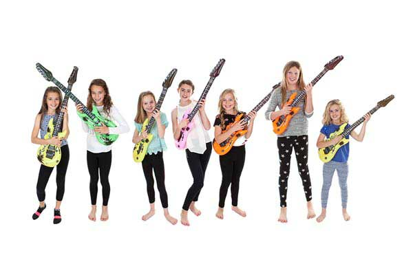 Photograph of girls with guitars during photoshoot party