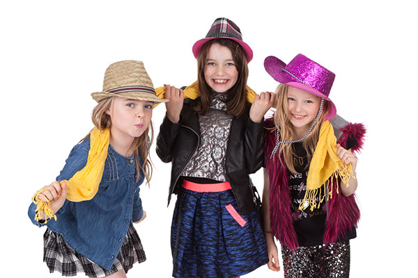 Three girls playing with hats and scarf during one of MCDAW Photography's - Photoshoot Parties