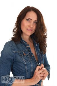Girl in denim jacket showing how to pose in photograph