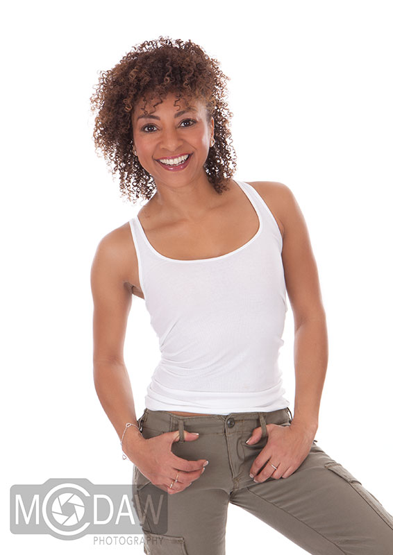 Girl in trousers and white top on how to pose in photograph taken by MCDAW Photography