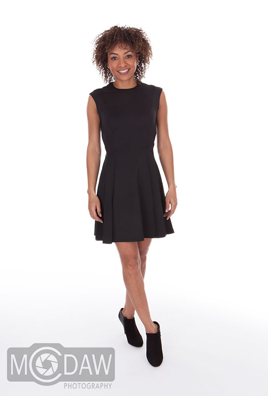 Girl in black dress on how to pose in photograph