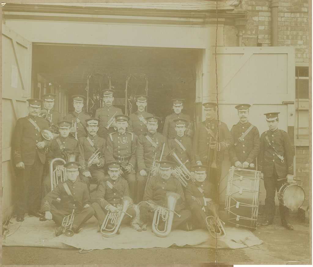 damaged print of Tonbridge Fire Brigade Band prior to photo restoration